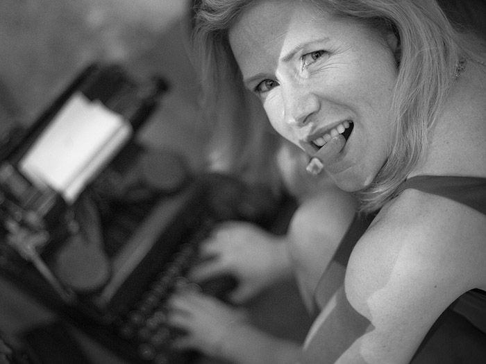 girl at typewriter with cigar